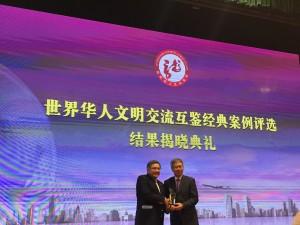 Ted receiving award in GUZ